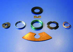 HK Metalcraft manufactures spring washers, wave washers, metal brackets, notched washers, and custom gaskets.