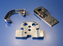 HK Metalcrafts works with you to deliver custom stamped brackets and and metal parts.